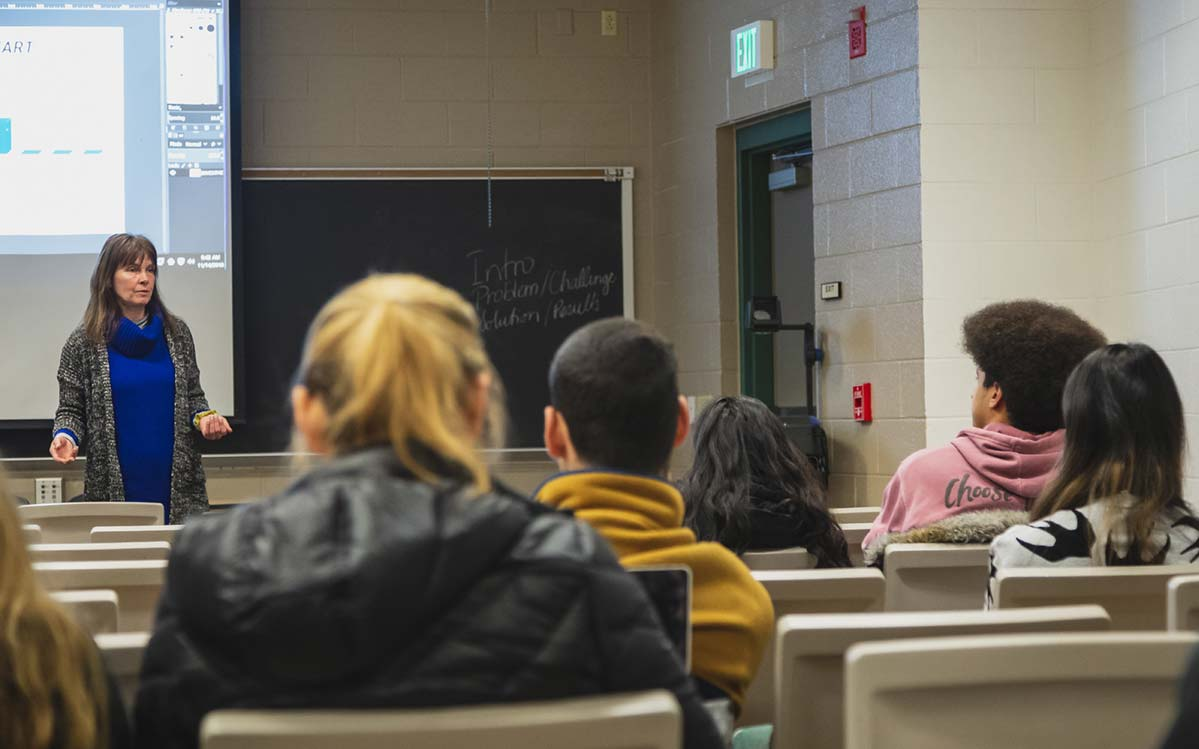 Students listening to a professor in a classroom
