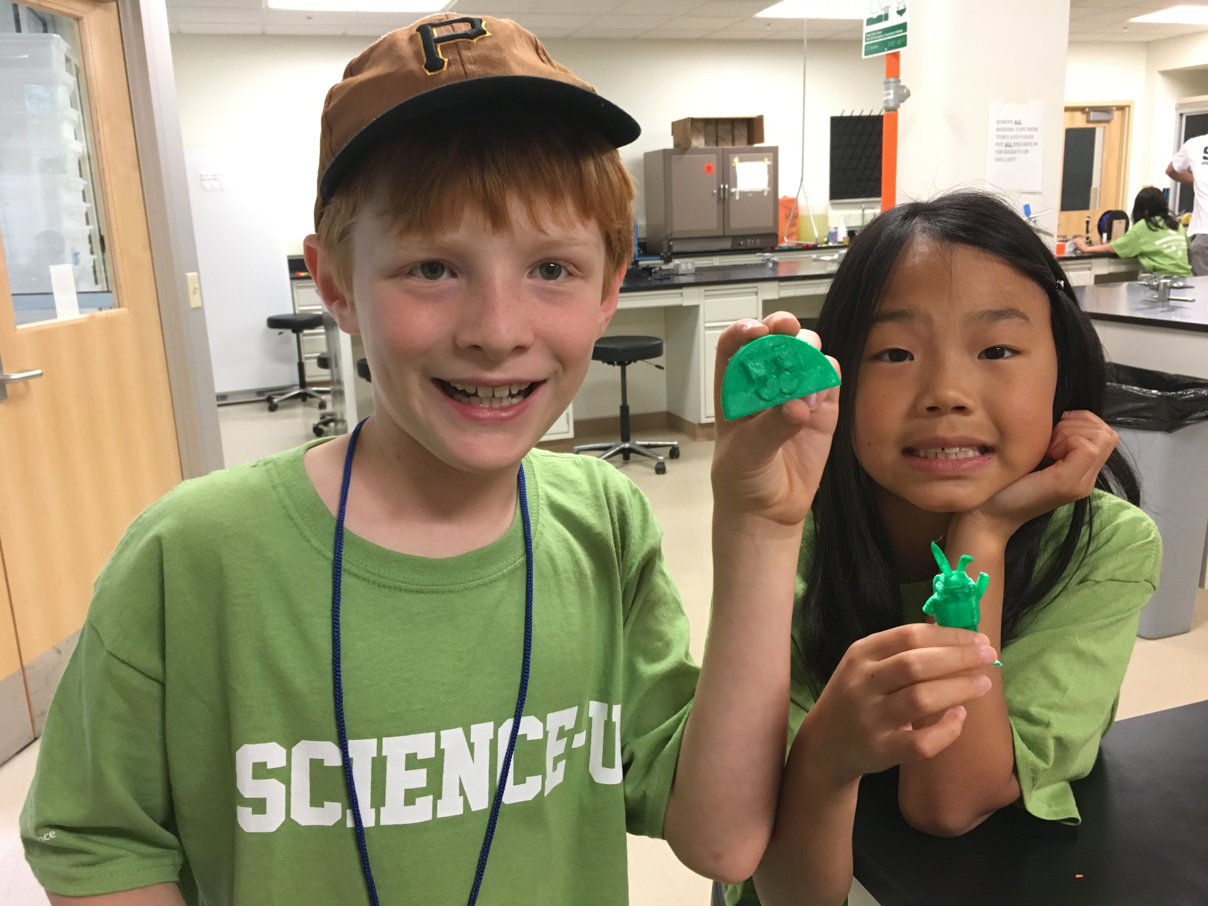 Campers at Science-U Summer Camp showing off their designs