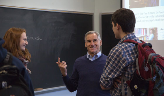 A professor having a conversation with two students