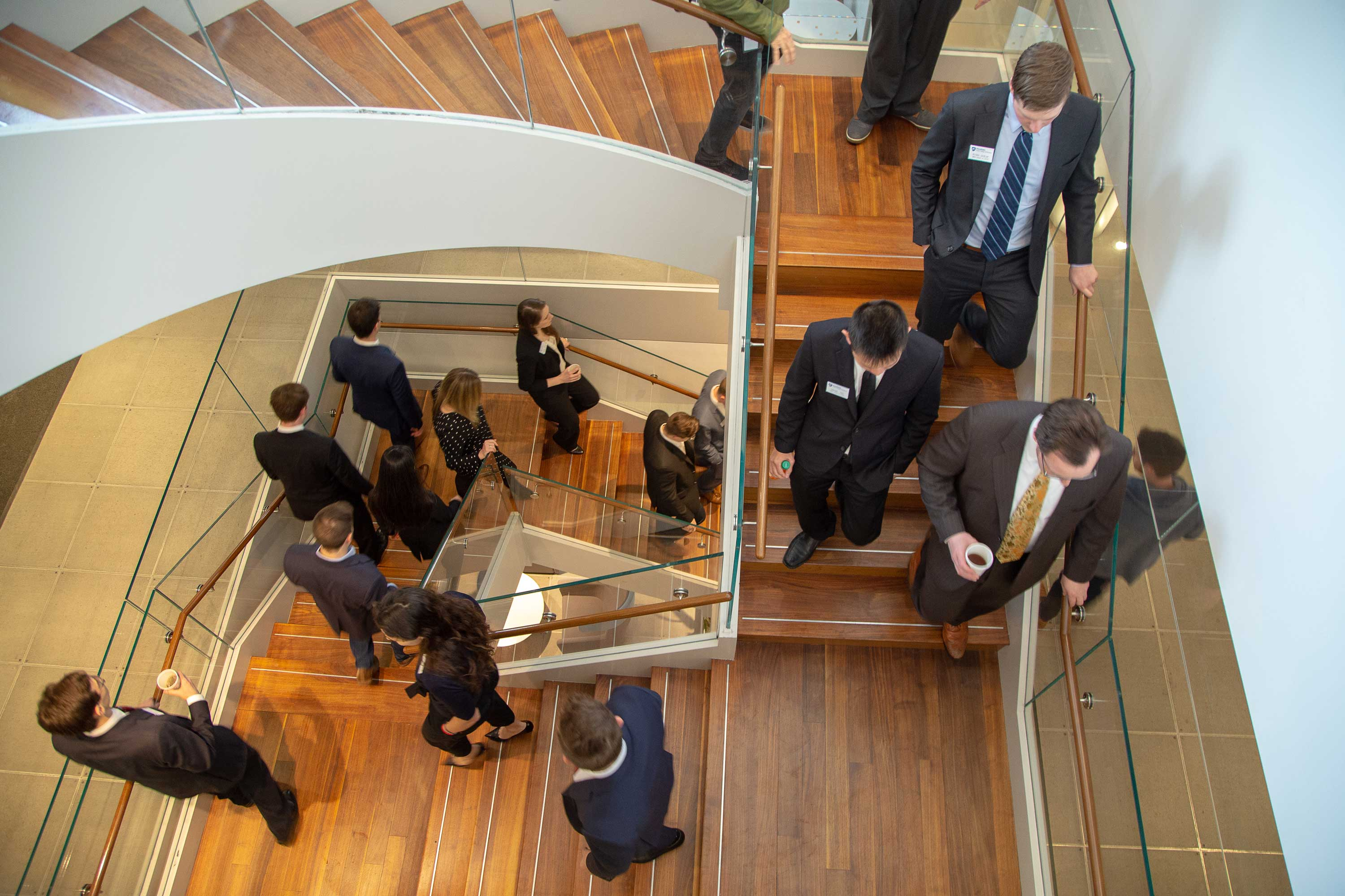 Students walking down a winding staircase
