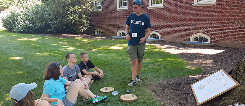 Science-U Mentor showing campers facts about trees