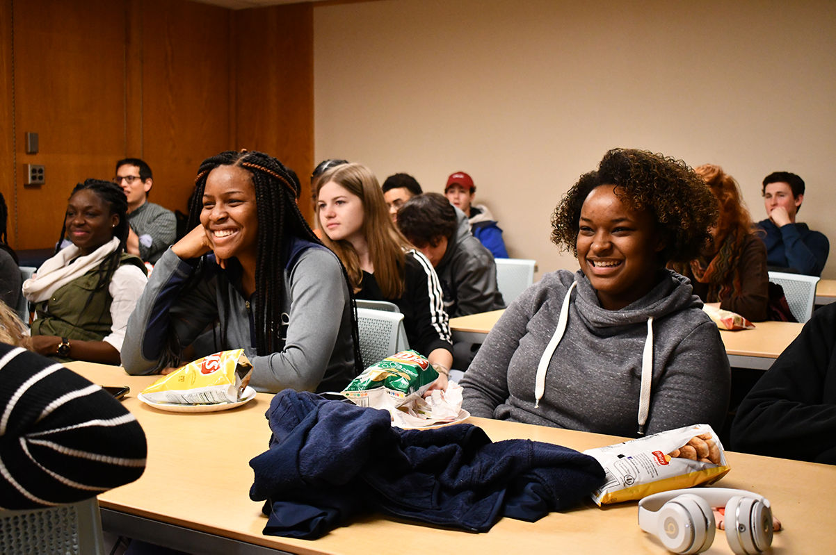 Smiling students sitting at tables