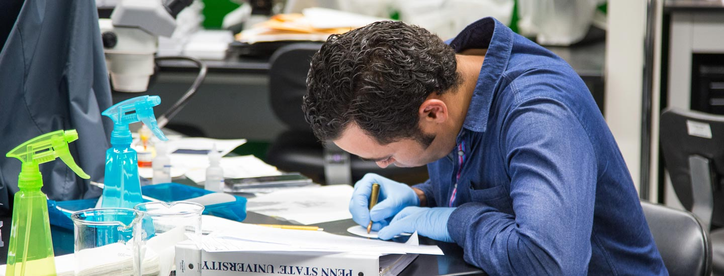 A forensic science student working in the laboratory.