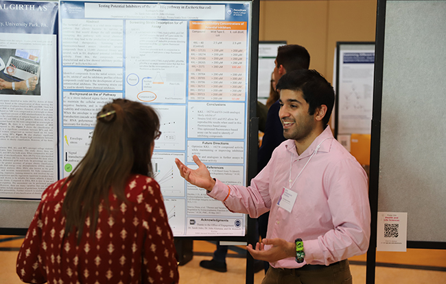 Student presenting research at a poster session