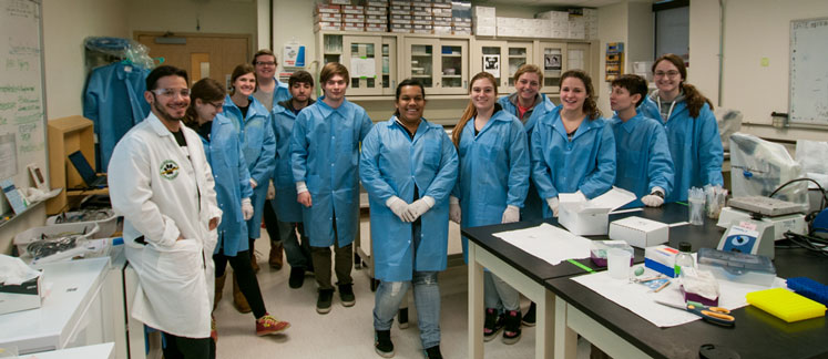 Forensic science students in forensic biology lab.