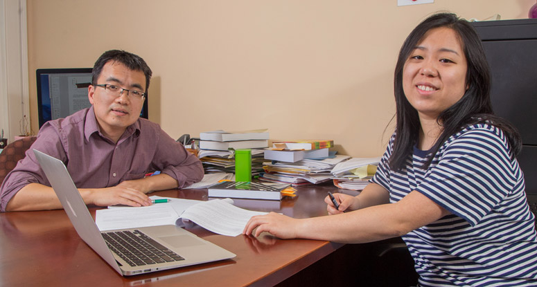 A faculty member in the mathematics department advising a student.