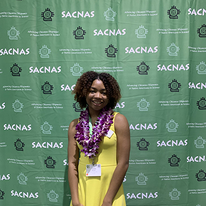 Ananda Rankin taking a photo at the SACNAS event