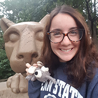Image of Victoria Bonnell posing next to the Penn State Lion Shrine