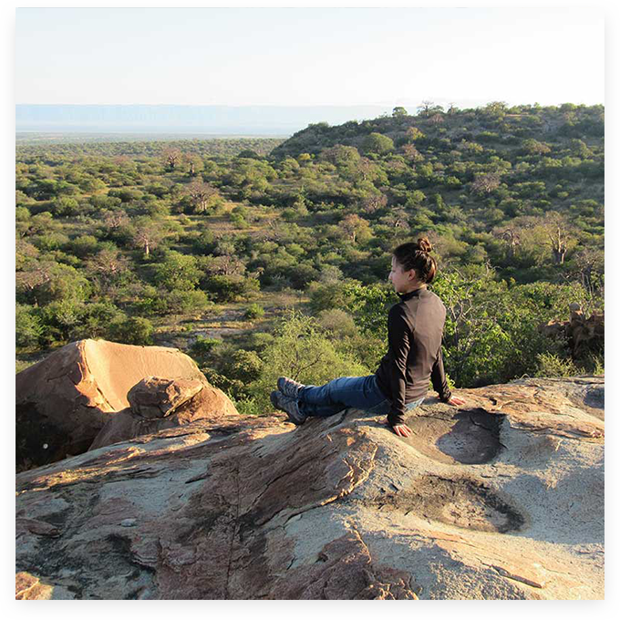 Student on a rock face in Tanzania