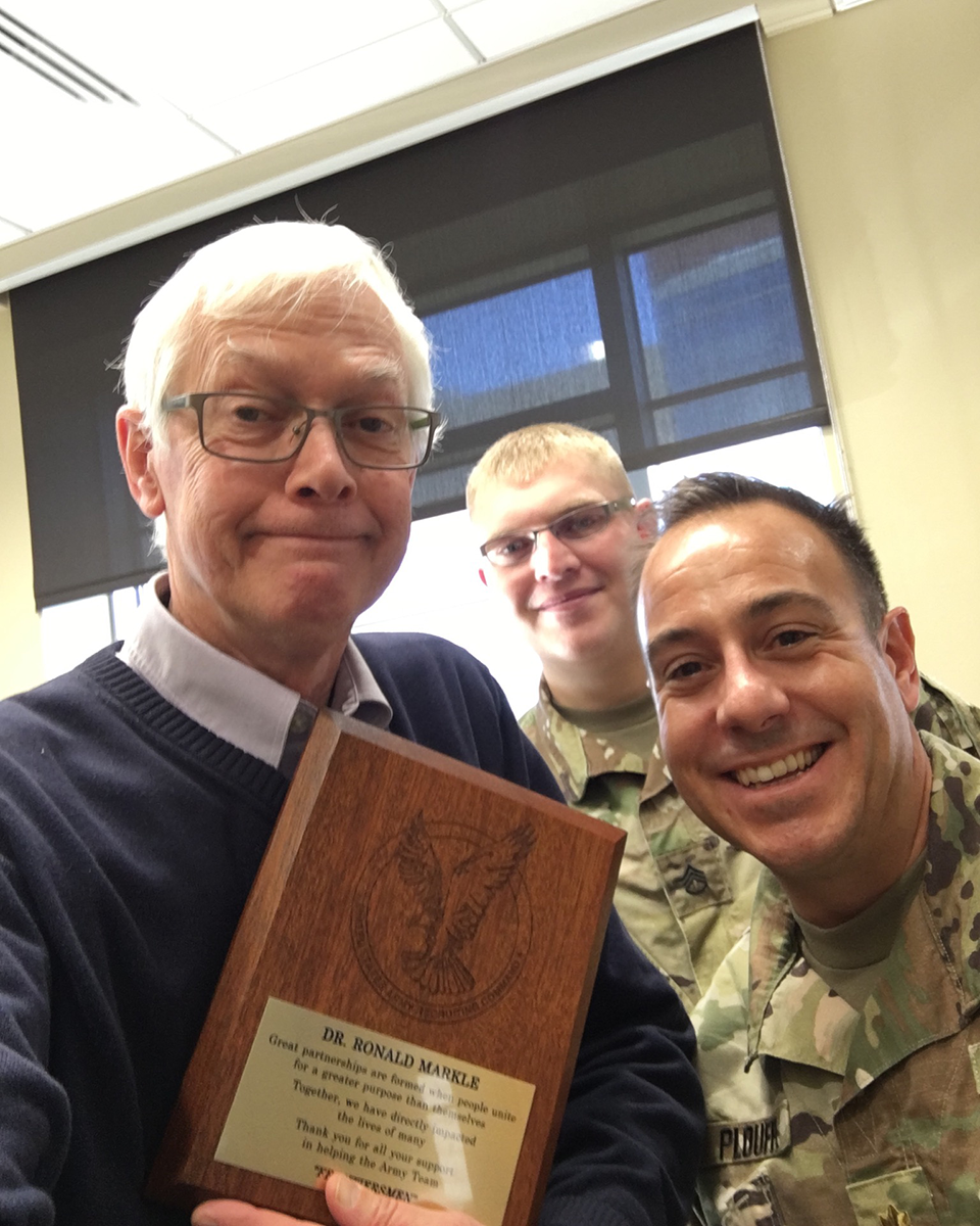 Dr. Ron Markle (left) and Maj. Matt Plouffe (right) with an Army HPSP recruit (center)