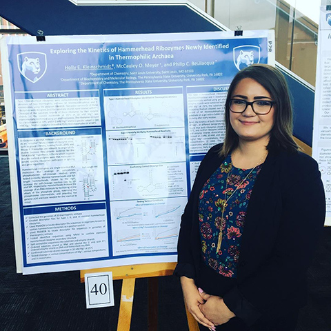 Image of Holly Kleinschmidt presenting a poster