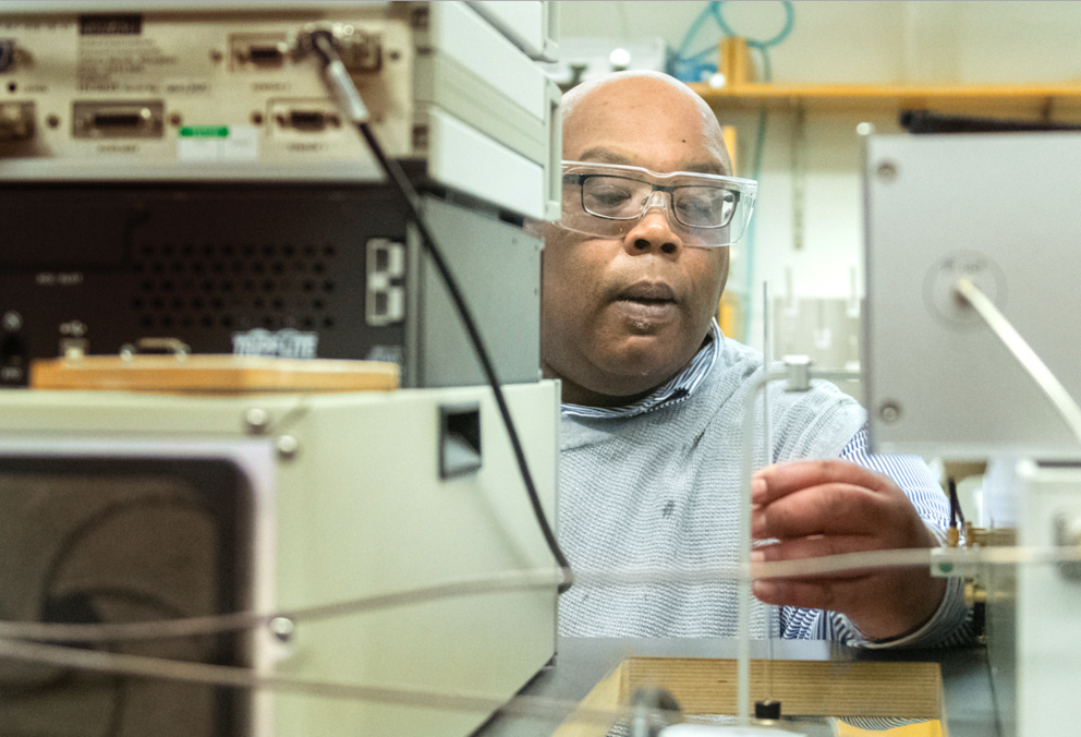 Squire Booker with lab equipment