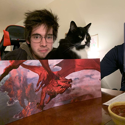 Image of Mitchell Godin and his cat playing Dungeons and Dragons