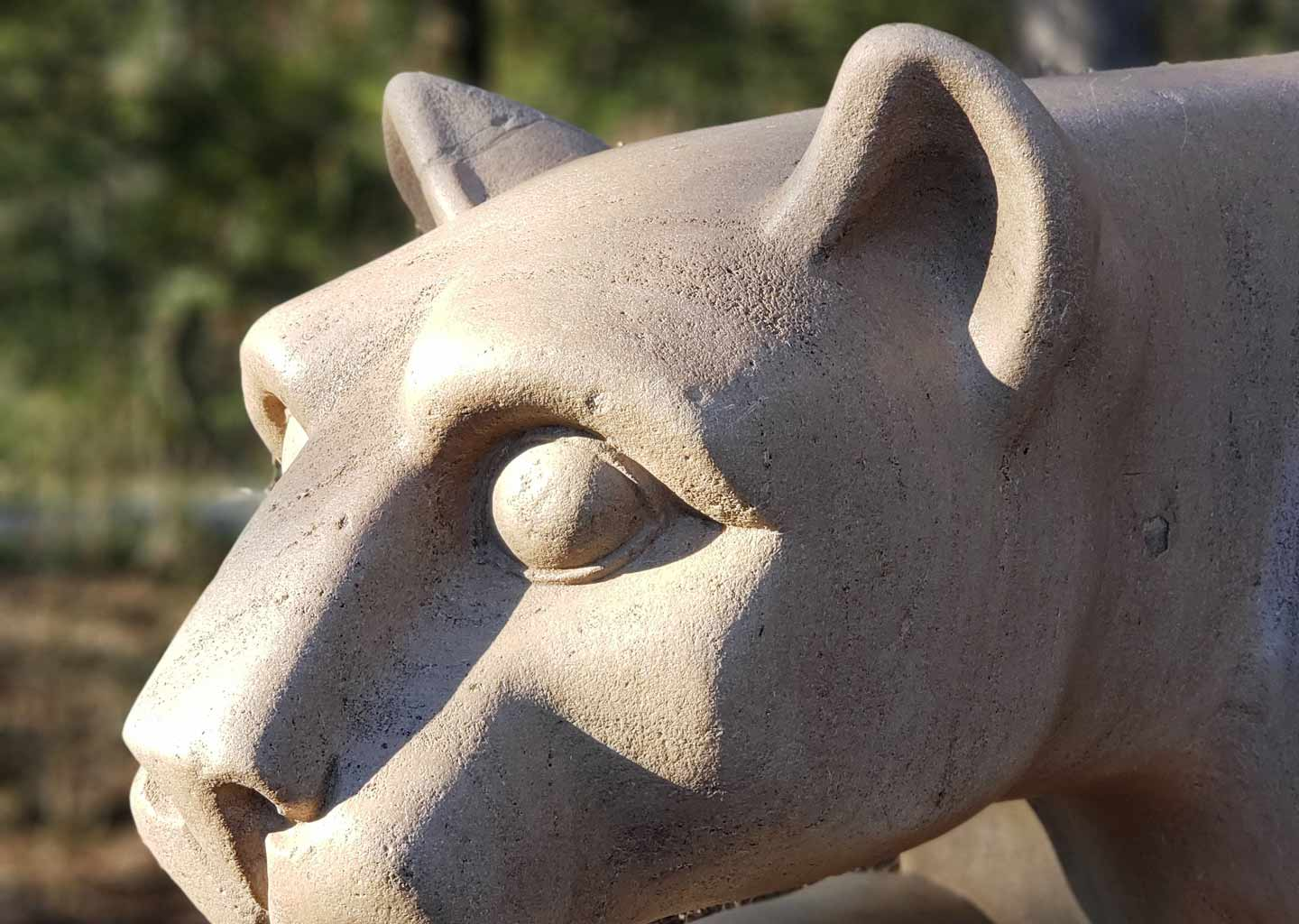 The Penn State lion shrine head at sunset