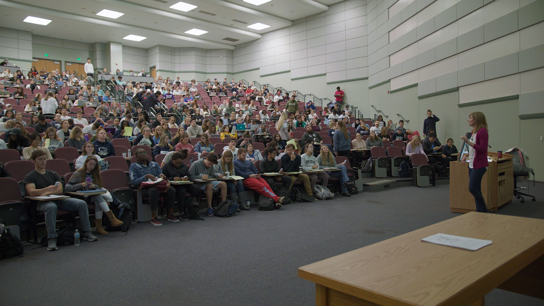 Students listening to a Professor in an auditorium