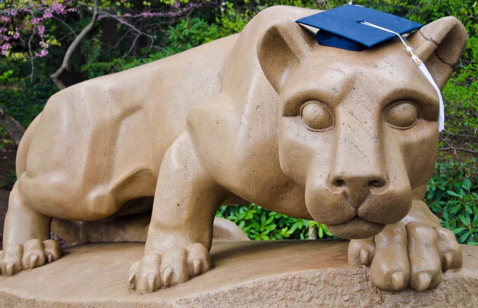 Lion shrine with mortar board
