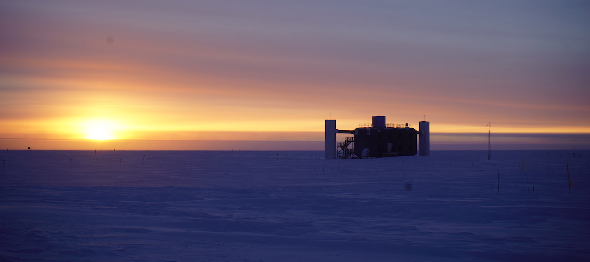 Sun setting behind the IceCube Lab at the South Pole. The Antarctic detector that identified the first likely source of high-energy neutrinos and cosmic rays, is getting an upgrade that will extend its scientific capabilities to lower energies. Credit: Kathrin Mallot, IceCube/NSF