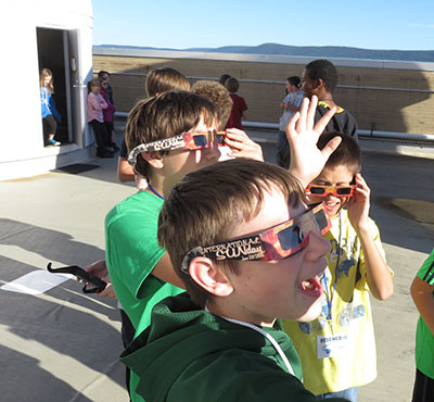 Think Outside the Beaker participants looking at sun with solar glasses
