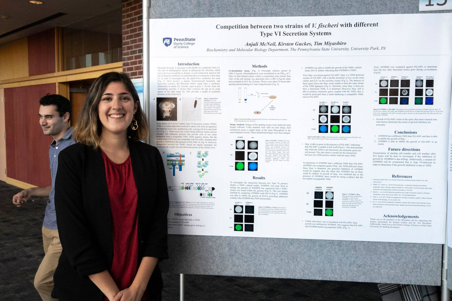 Image of Anjali McNeil standing next to her research poster at the Undergraduate Research Exhibition at Penn State