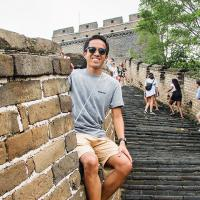 Joaquim Diego Santos sitting on the Great Wall of China