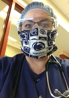 Dolan wearing mask with Penn State fabric