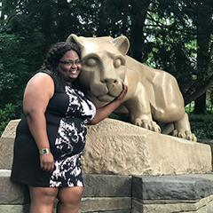 Image of Cailtan Surgeon posing with the Penn State Nittany Lion Shrine